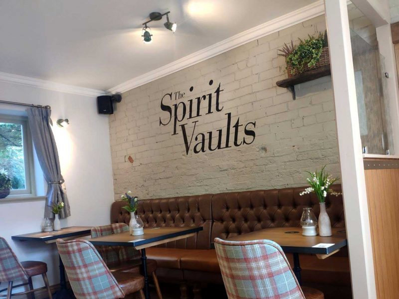 Spirit Vaults Interior Sign on wall